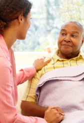 caregiver talking to a senior woman