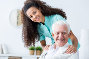 caregiver taking good care of an elderly man