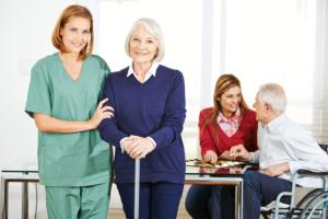 caregivers assisting elderly seniors